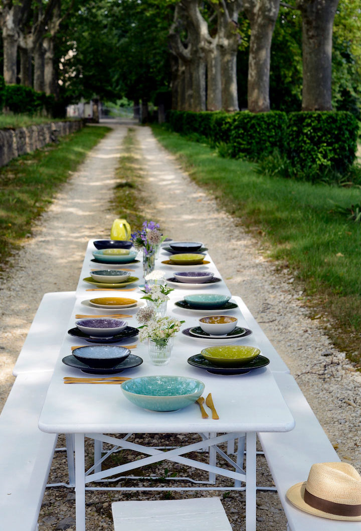 Jars stoneware set out on a table outdoors