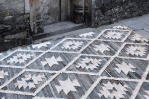 A handwoven grey rug from The Rug Republic
